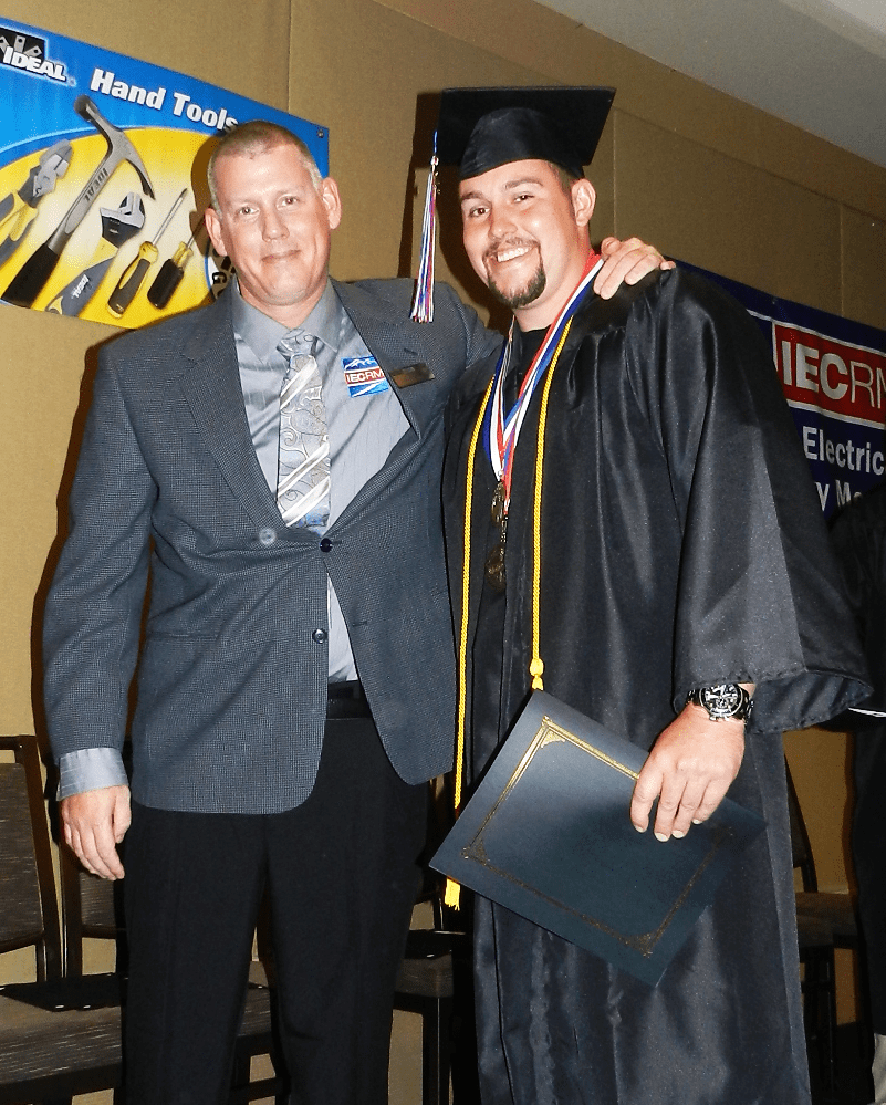 Paul Lingo, Assistant Training Director, with Valedictorian Kole Towner